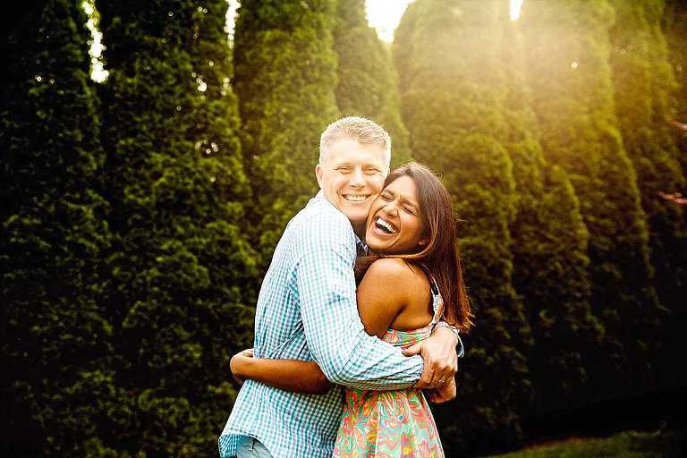 husband wife hugging and smiling, madison couples photographer