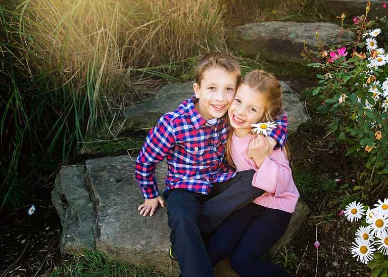 brother and sister smiling, westbrook child photographer